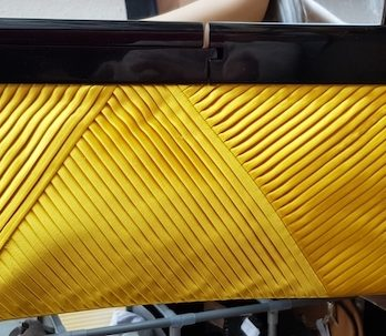 Clutch Reiss in Gelb Textil