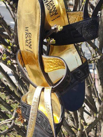 Schuhe Versace Größe 38,5 in Schwarz/Gold aus Leder